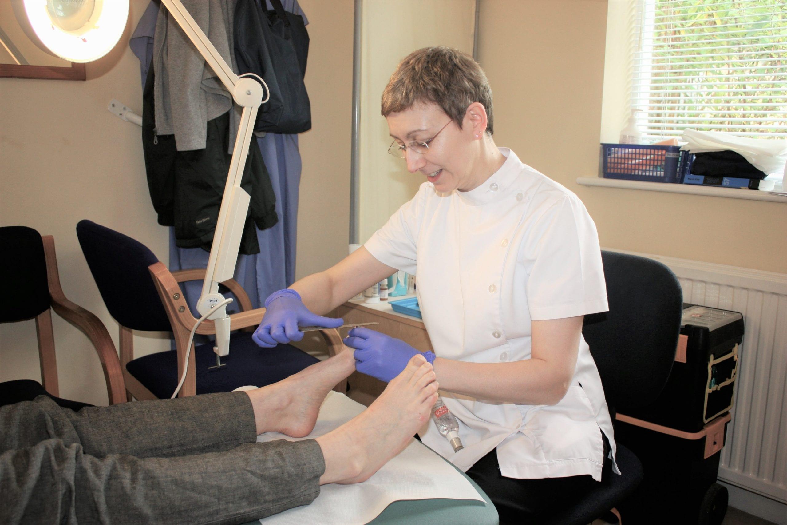 Photo of Sue Beynon summertown Clinic's podiatrist at work