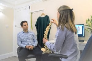 Nadine Harrison - Chiropractor talking to a patient